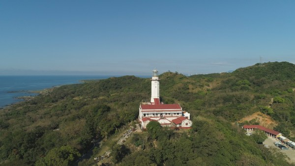 Aerial view of Lighthouse on hill. Cape Bojeador Lighthouse, Burgos, Ilocos Norte, Philippines.