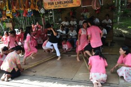 Tourists and Locals dancing Tinikling