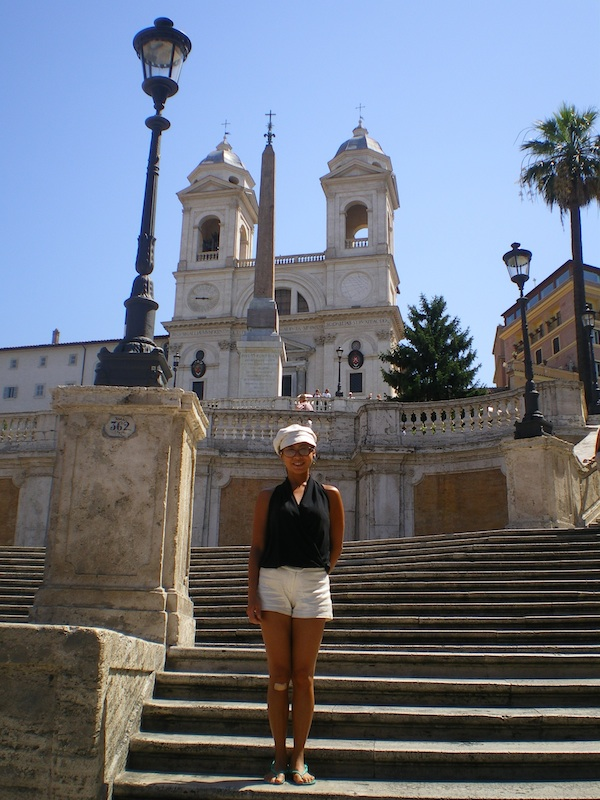 Amanda at Piazza di Spagna with a looming view of Trinita Dei Monti (July 2009)
