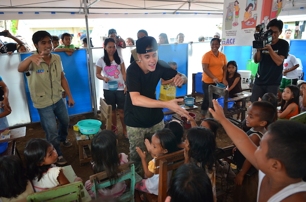 JB singing with kids in Tacloban