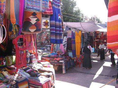 The Saturday market in Otavalo, showing the colourful fabrics
