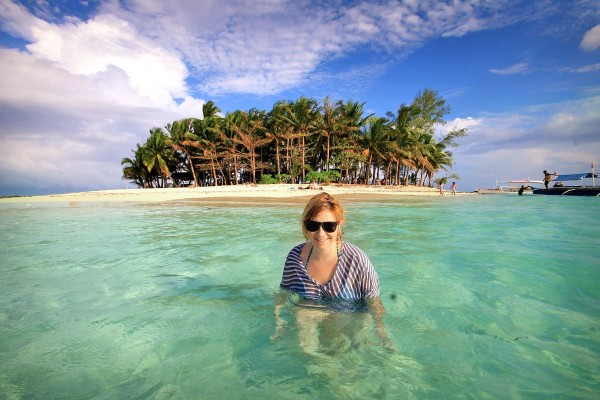 Sabrina enjoying the clear waters of Guyam Island in Siargao Philippines