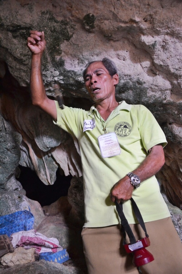 Tour Guide showing a potion found inside the Mystical Cave