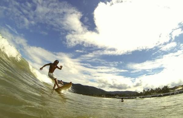 Surfing in Baler Aurora by Chris Juloya
