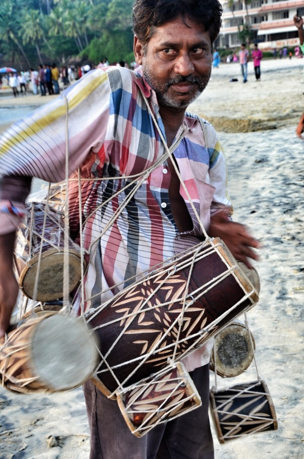 Beach Peddler selling traditional drums