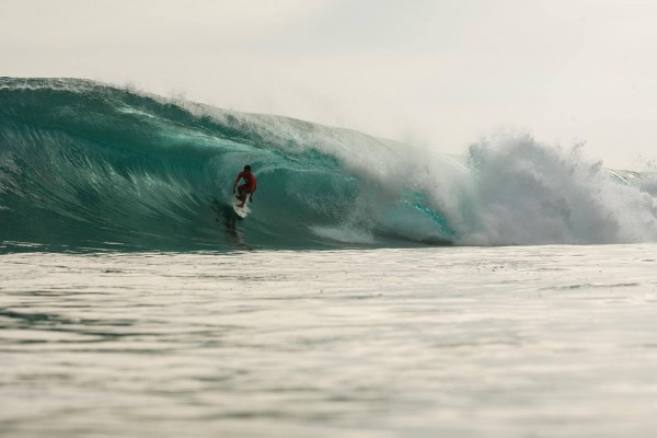 Surfing in Puraran photo by Puraran Surf Beach Resort