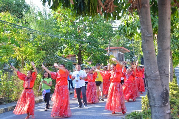 PHILTOA President Mr. Cesar Cruz performing Sublian Karakol dance in the streets of Talisay Batangas together with local cultural performers and Tour Participants