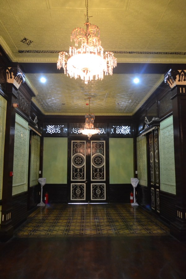 one spacious corridor with intricate wall designs