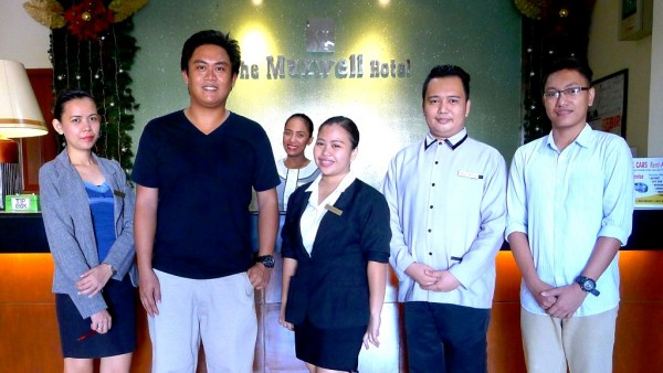 The King of Sinulog with the Maxwell Hotel Team