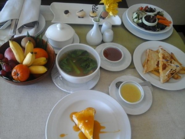 In-room meal of Grilled Cheese Sandwich, Chicken Wanton Soup, Fresh Garden Salad with Homemade Pineapple Dressing, Mango Cheesecake and delicious sweet treats.