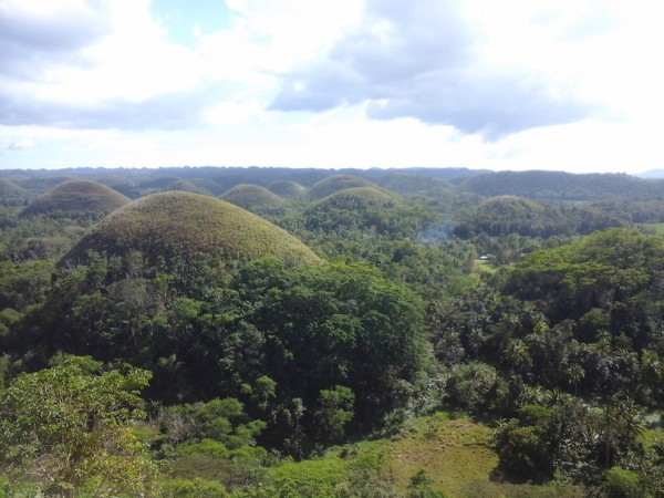 Verdant Chocolate Hills during pre-summer