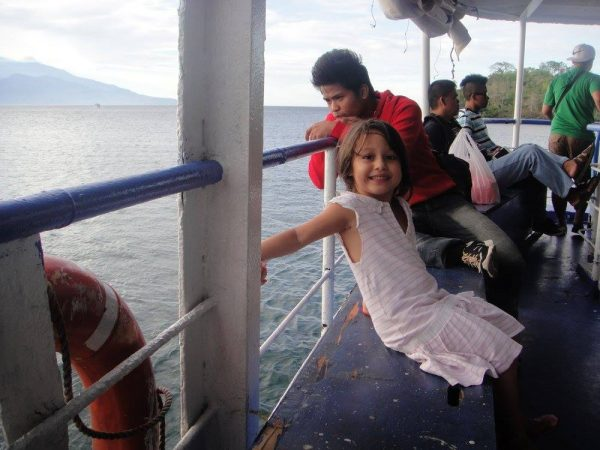 A happy child on board the ferry to Benoni