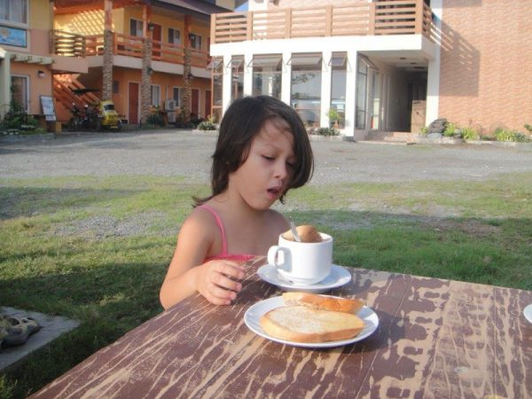 Luna's simple breakfast joys of bread dipped in hot chocolate
