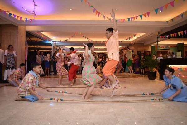Pas Des Tous group performing the Tinikling, Philippine's National Dance