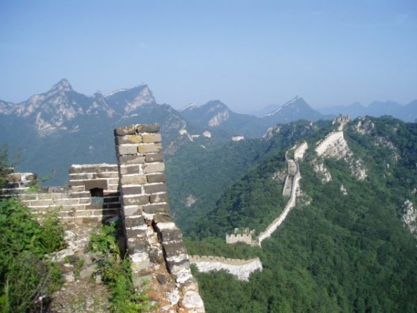 A more rural portion of the Great Wall that stretches throughout the mountains, here seen in slight disrepair photo via Wikipedia