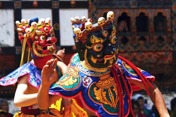 Dancers with colorful mask dance at a yearly festival called tse