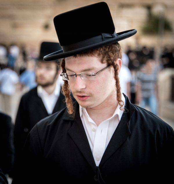 A Jewish male must leave sideburns (peyot) down to the joints of the jaw that are opposite the ear, approximately a third of the way down the ear.