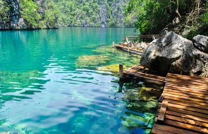 Very Clean and Clear Kayangan Lake next to a wooden path