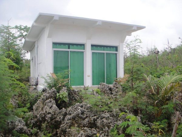 One of three concrete cabanas overlooking the sea