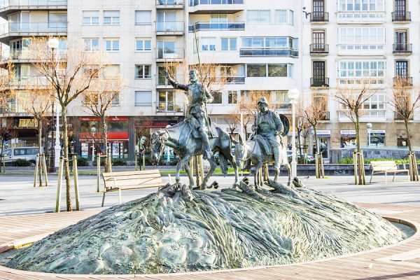 Sculpture of famous Spanish Don Quixote and Sancho Panza in San Sebastian Spain
