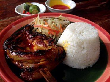Chicken Inasal served with freshly made atchara and white rice
