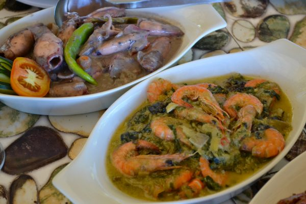 Squid and shrimps prepared and cooked with a kick of spice and coconut milk.