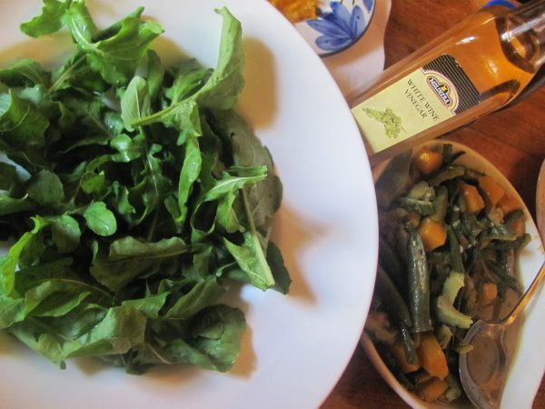 A power meal of fresh arugula greens and stewed vegetables