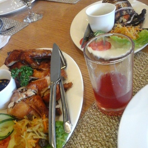Lunch a la Carte dishes of Spring Chicken and Grilled Squid with a bit of Strawberry Juice