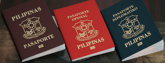 Different versions of the Philippine passport. From left to right: regular, official, diplomatic
