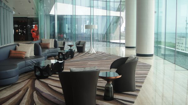 Conrad Manila's lobby with a generous view of Manila Bay.