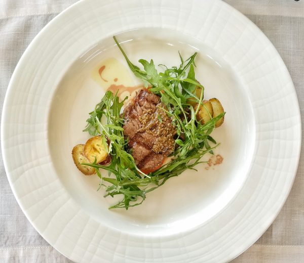 """US Beef Tenderloin """"Mignonettes,"""" a premium slab of beef served with Togarashi potatoes and Tagaytay tomatoes topped with fresh greens drizzled with toasted spice vinaigrette"""