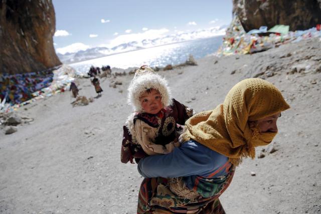 A Tibetan pilgrim is circling sacred Namtso Lake