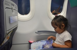 On her seat, prior to take-off