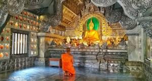 A praying Monk inside Wat Srisuphan