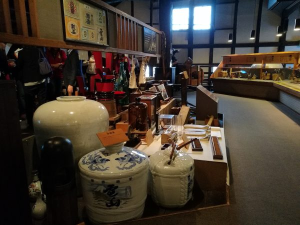 Old Sake brewing tools displayed inside the Museum