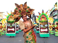 Performers donned eye-catching costumes highlighted by their beautiful smiles - Photo by Teddy Pelaez