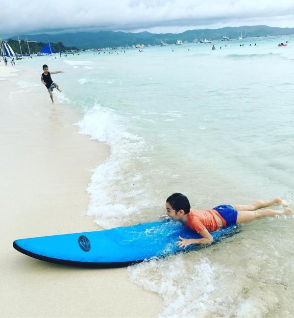 Fun splashes at Boracay's long white beach