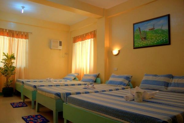 Neat and comfy rooms for the family at White Beach Resort