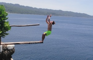 A commencing back-flip from the 9-meter board