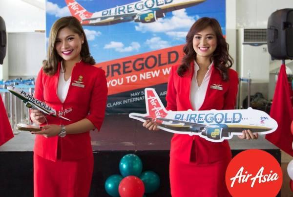 AirAsia Crew presenting the new AirAsia Puregold plane livery
