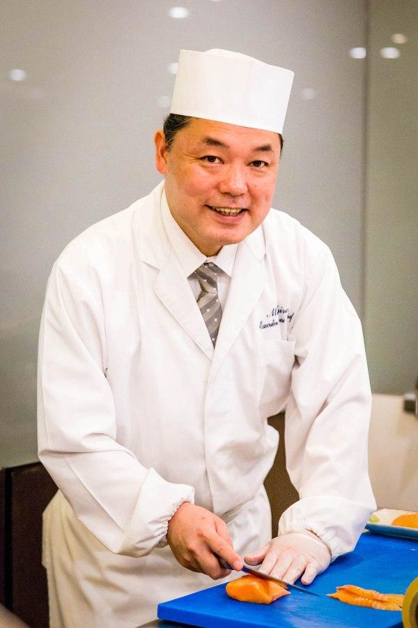Chef Hiro cutting salmon