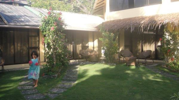Tropical flowers enlivening the soft grass around the Deluxe Rooms