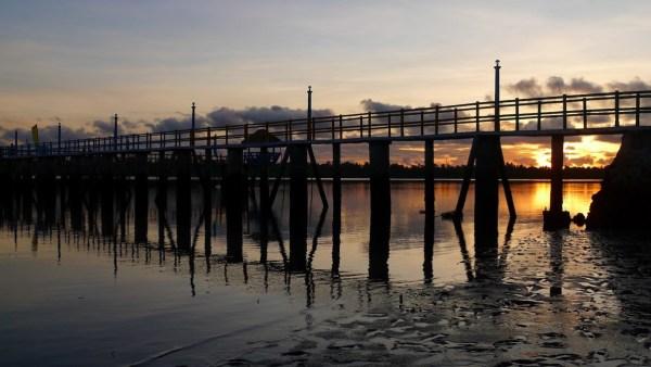 Boardwalk shadow at sunrise