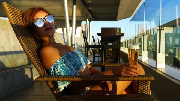 Enjoying a glass of Heineken on tap