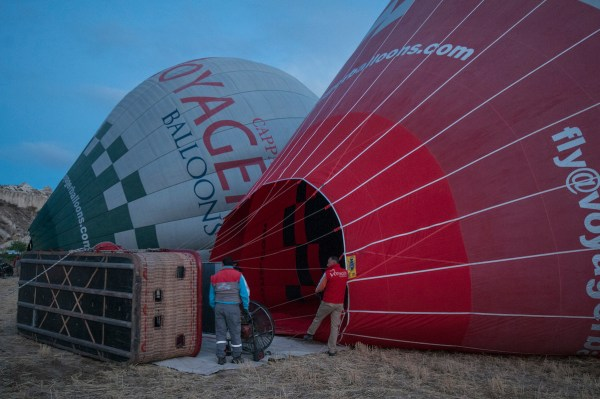 Getting the balloon ready as it lies on the ground