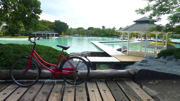 Ride bikes around Plantation Bay
