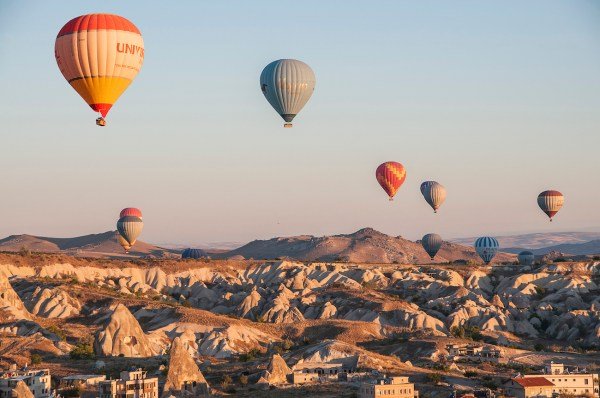 The wind lines them up above the outskirts of Goreme.