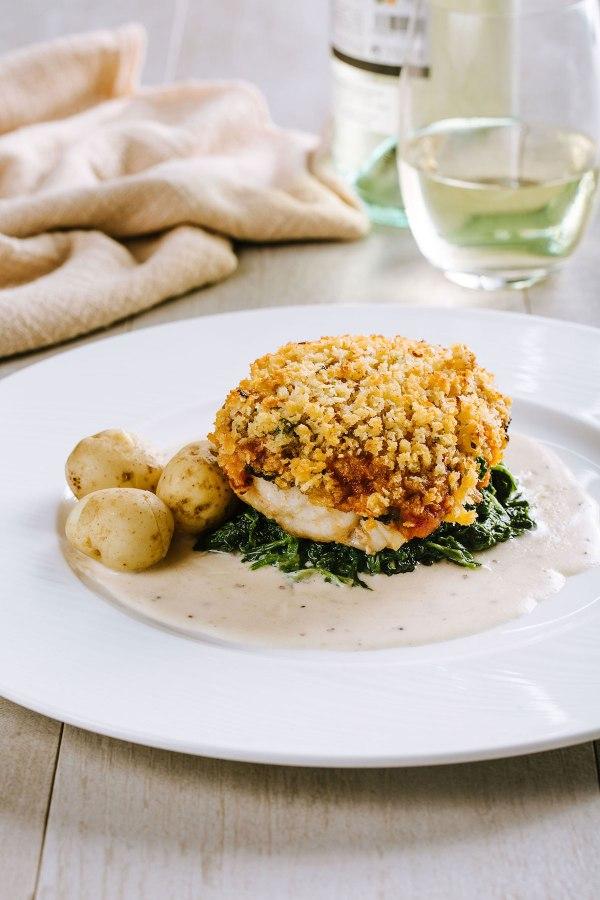 Gratinated Fillet of Chilean Sea Bass with Lemon Parsley Crust - New A La Carte Menu of Cucina