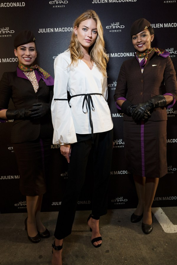 Model Martha Hunt is pictured in London with members of Etihad Airways' cabin crew at the Julien Macdonald VIP Party sponsored by the airline