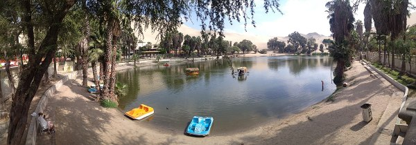 Huacachina is a desert oasis and tiny village just west of the city of Ica in southwestern Peru